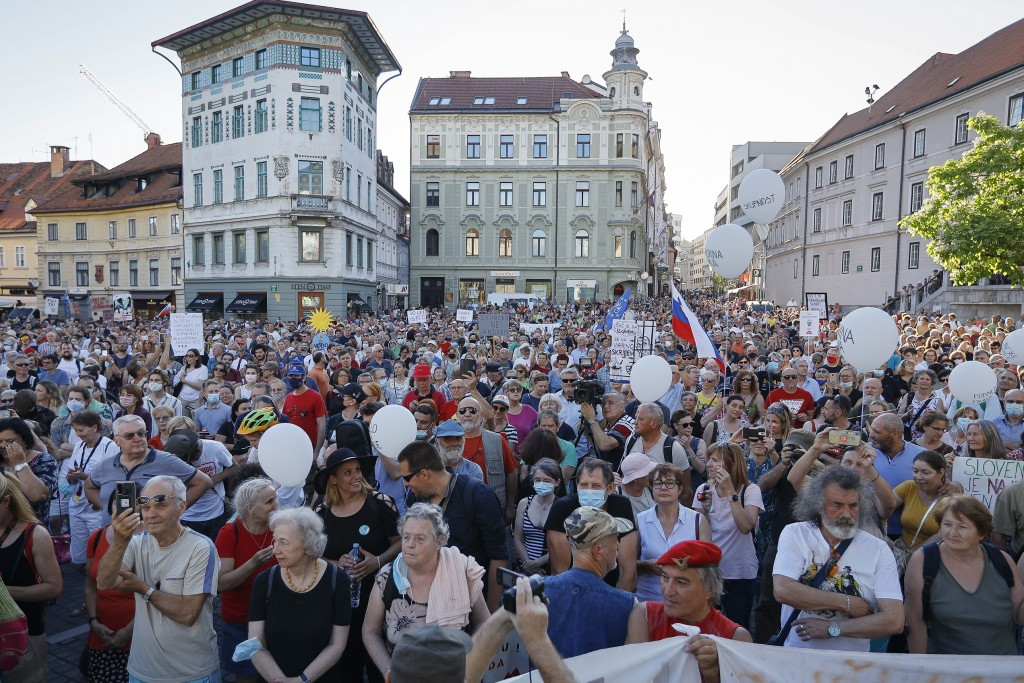 In this Friday, June 25, 2021 file photo, protesters rally during an anti-government demonstration in Ljubljana, Slovenia, Friday, June 25, 2021. Slov...