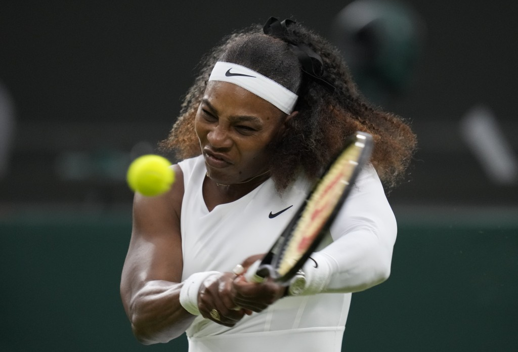 Serena Williams of the US plays a return to Aliaksandra Sasnovich of Belarus for the women's singles first round match on day two of the Wimbledon Ten...