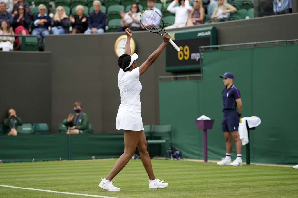 Venus Williams of the US celebrates winning the women's singles first round match against Romania's Mihaela Buzarnescu on day two of the Wimbledon Ten...