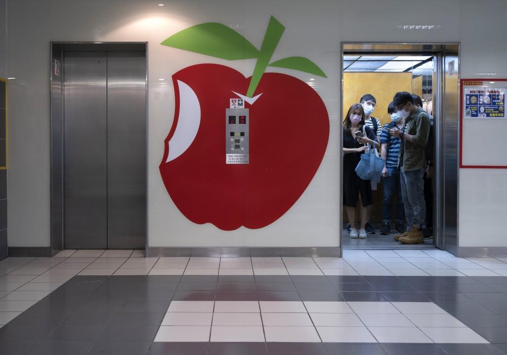 Apple Daily logoatlift lobby outsidenewsroom of Apple Daily in Hong Kong.