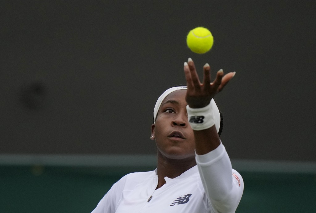 Coco Gauff of the US serves to Britain's Francesca Jones during the women's singles first round match on day two of the Wimbledon Tennis Championships...
