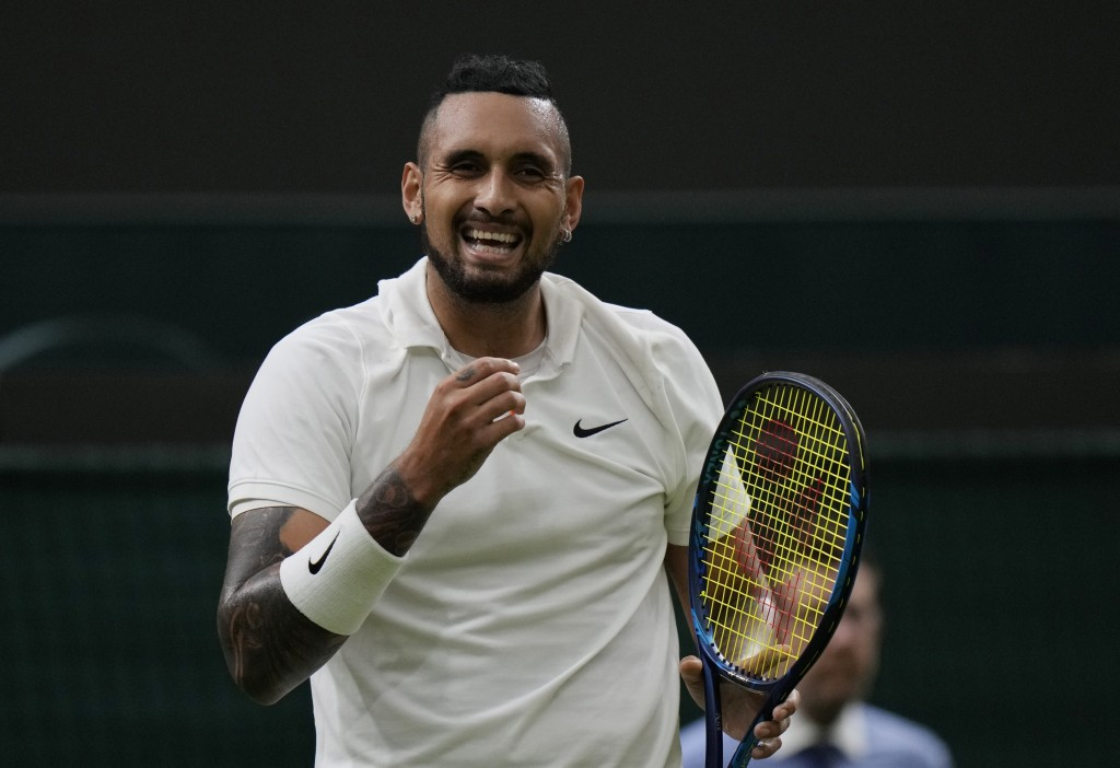 Australia's Nick Kyrgios smiles during the men's singles first round match against Ugo Humbert of France on day two of the Wimbledon Tennis Championsh...