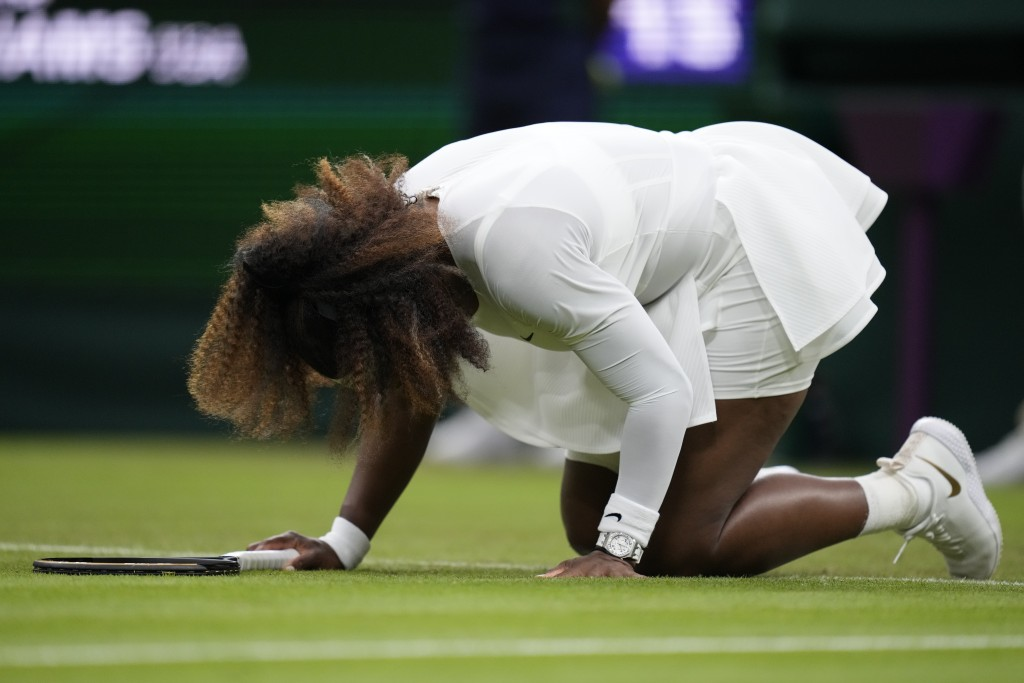Serena Williams of the US falls to the ground during the women's singles first round match against Aliaksandra Sasnovich of Belarus on day two of the ...