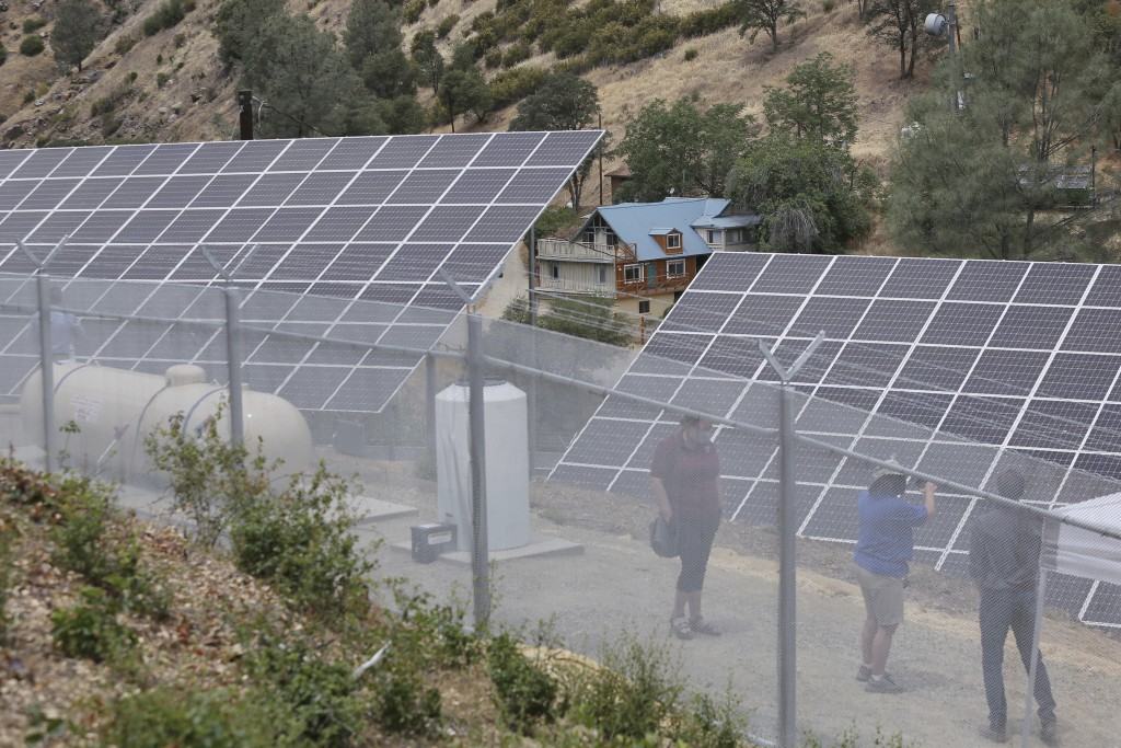 A house shown in the distance is powered by Pacific Gas & Electric's new Remote Grid Initiative site shown near Yosemite National Park in Briceburg, C...