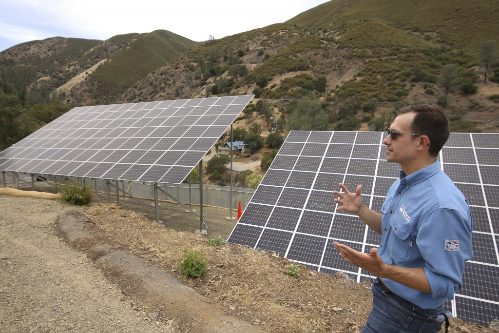 Program lead Bennett Chabot stands by Pacific Gas & Electric's new Remote Grid Initiative site near Yosemite National Park in Briceburg, Calif., on Ju...