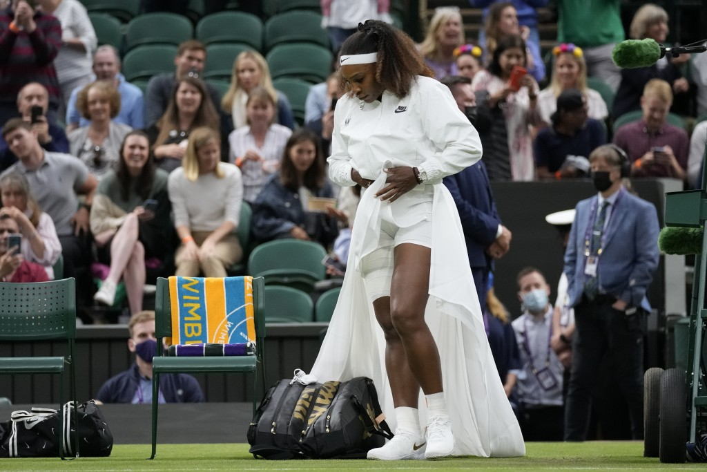 Serena Williams of the US walks onto Centre Court for the women's singles first round match against Aliaksandra Sasnovich of Belarus on day two of the...