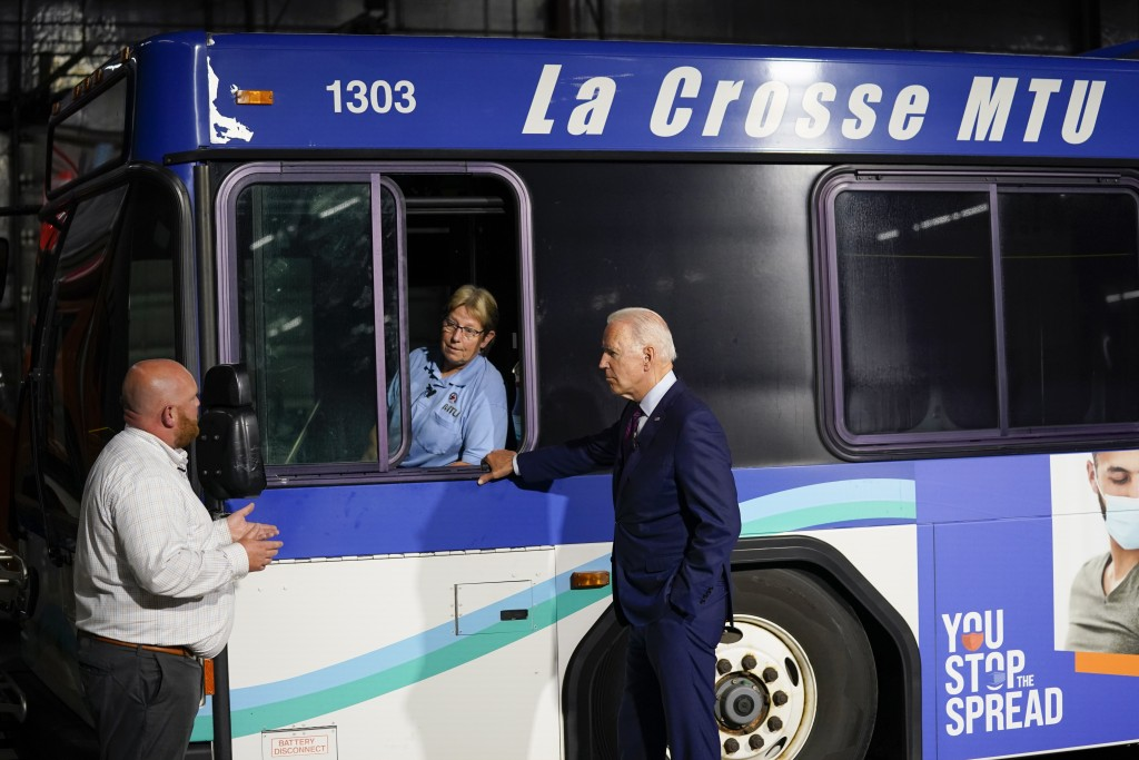 President Joe Biden participates in a tour of the La Crosse Municipal Transit Authority with Adam Lorentz, Transit Manager, La Crosse Municipal Transi...