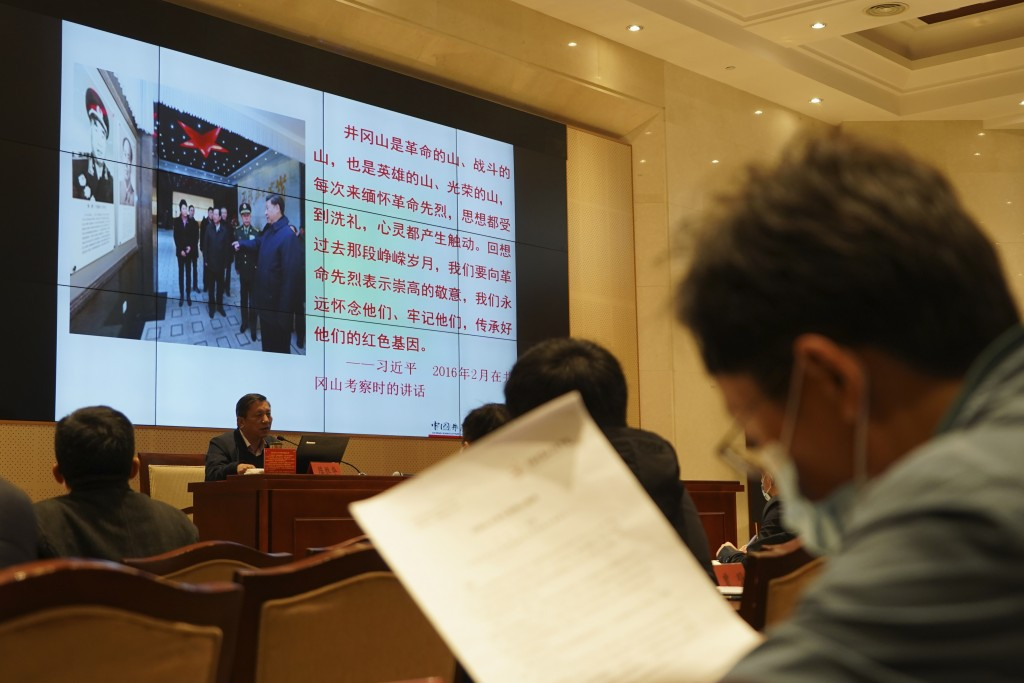 A lecturer conducts a class for students at the China Executive Leadership Academy in Jinggangshan in southeastern China's Jiangxi Province, on April ...