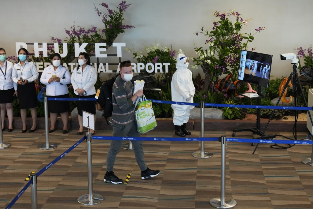The first group of tourists from Abu Dhabi arrives at the Phuket International Airport in Phuket, Thailand, Thursday, July 1, 2021. Starting Thursday,...