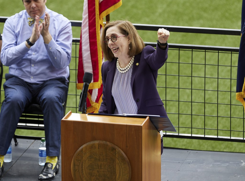 Oregon Governor Kate Brown pumps her fist while announcing the end of the state's COVID-19 restrictions in Portland, Ore., Wednesday, June 30, 2021. (...
