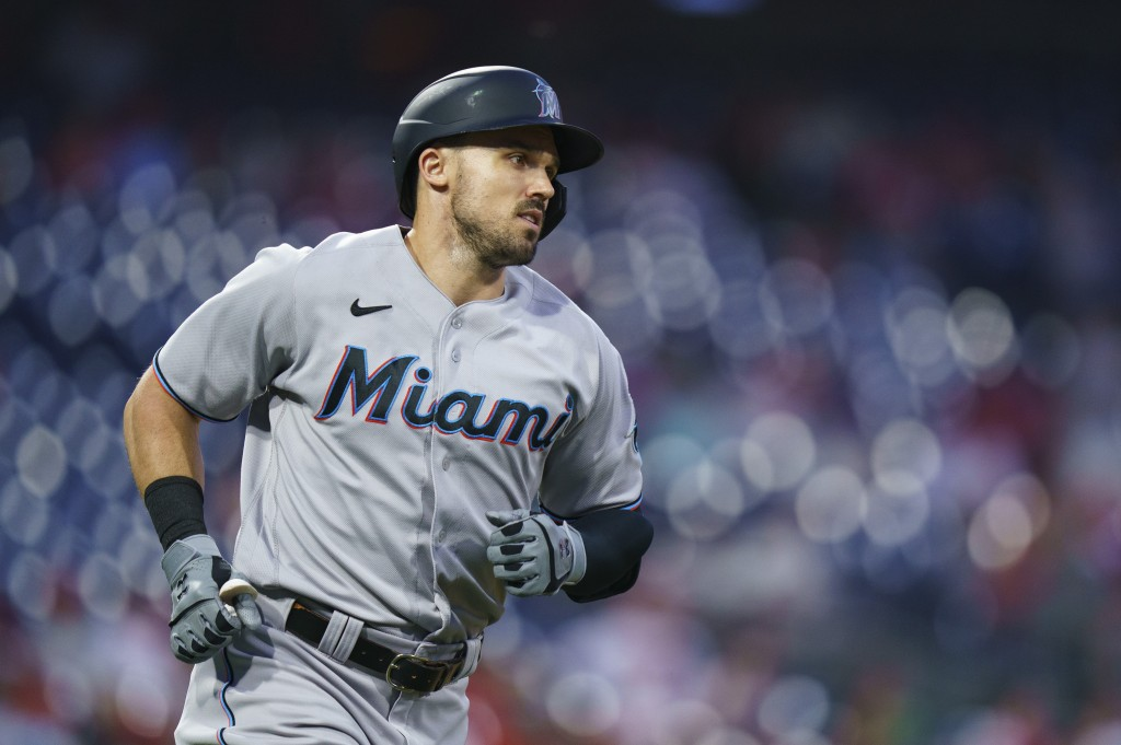Miami Marlins' Adam Duvall rounds the bases after hitting a home run during the fourth inning of the team's baseball game against the Philadelphia Phi...