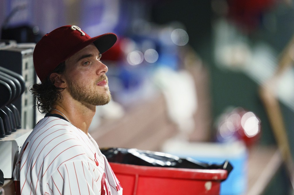 Philadelphia Phillies starting pitcher Aaron Nola looks ou5 from the dugout as he was pulled from the baseball game during the fifth inning against th...