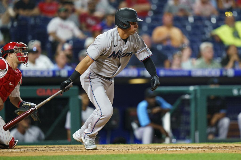 Miami Marlins' Joe Panik heads to first on an RBI single during the fifth inning of the team's baseball game against the Philadelphia Phillies, Wednes...