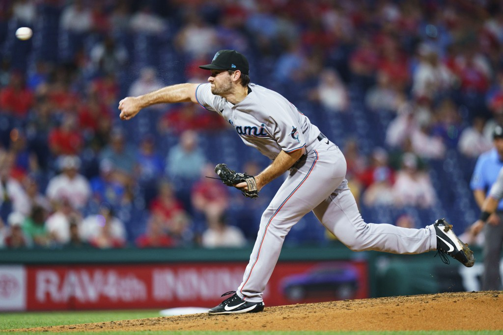 Miami Marlins relief pitcher Zach Pop throws a pitch during the fourth inning of the team's baseball game against the Philadelphia Phillies, Wednesday...