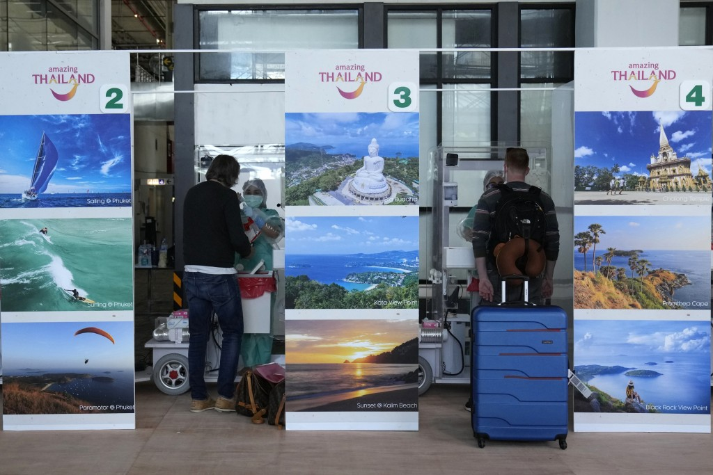 The first group tourist are tested for the COVID-19 after arriving at the Phuket International Airport in Phuket, Thailand, Thursday, July 1, 2021. St...