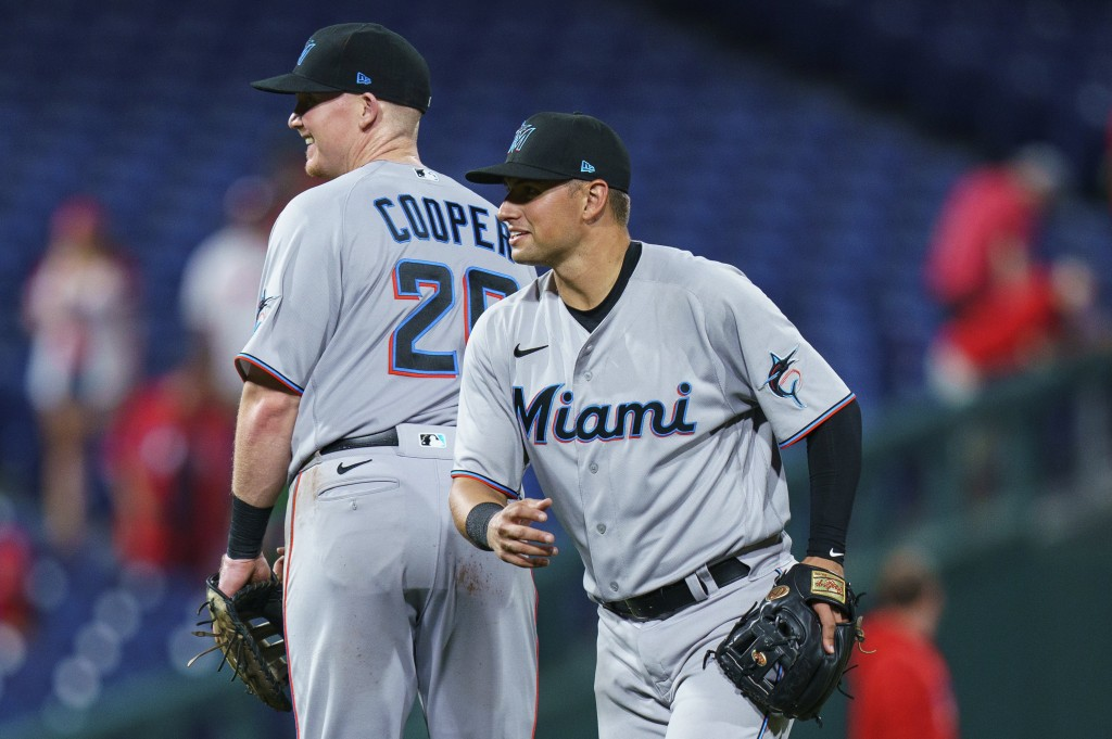 Miami Marlins' Joe Panik, right, celebrates the team's win with Garrett Cooper, left, following a baseball game against the Philadelphia Phillies, Wed...