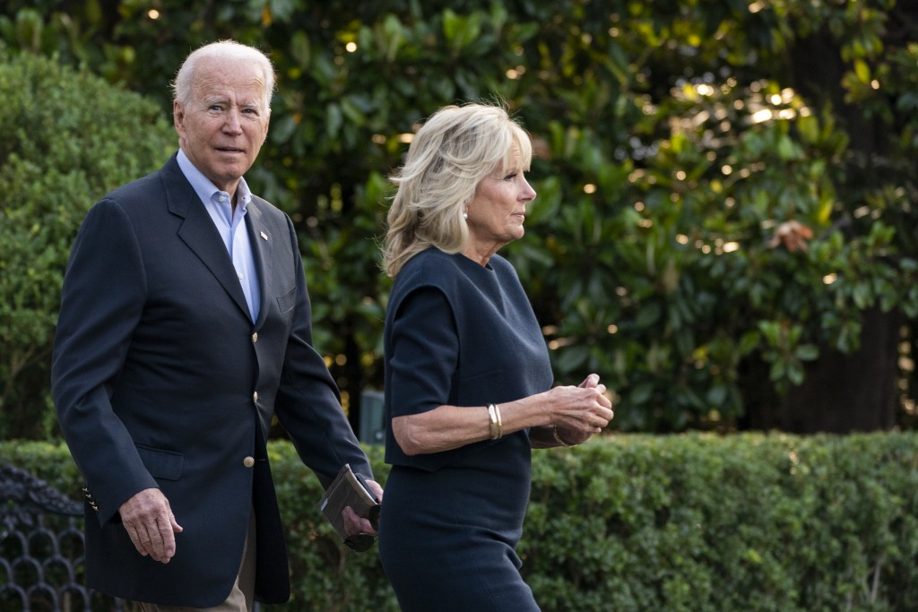 President Joe Biden and first lady Jill Biden walk on the South Lawn at the White House in Washington, Thursday, July 1, 2021, to board Marine One on ...