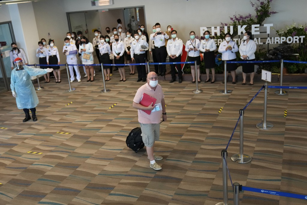 One of the first tourists arrive from Abu Dhabi at the Phuket International Airport in Phuket,  Thailand, Thursday, July 1, 2021. Starting Thursday, T...