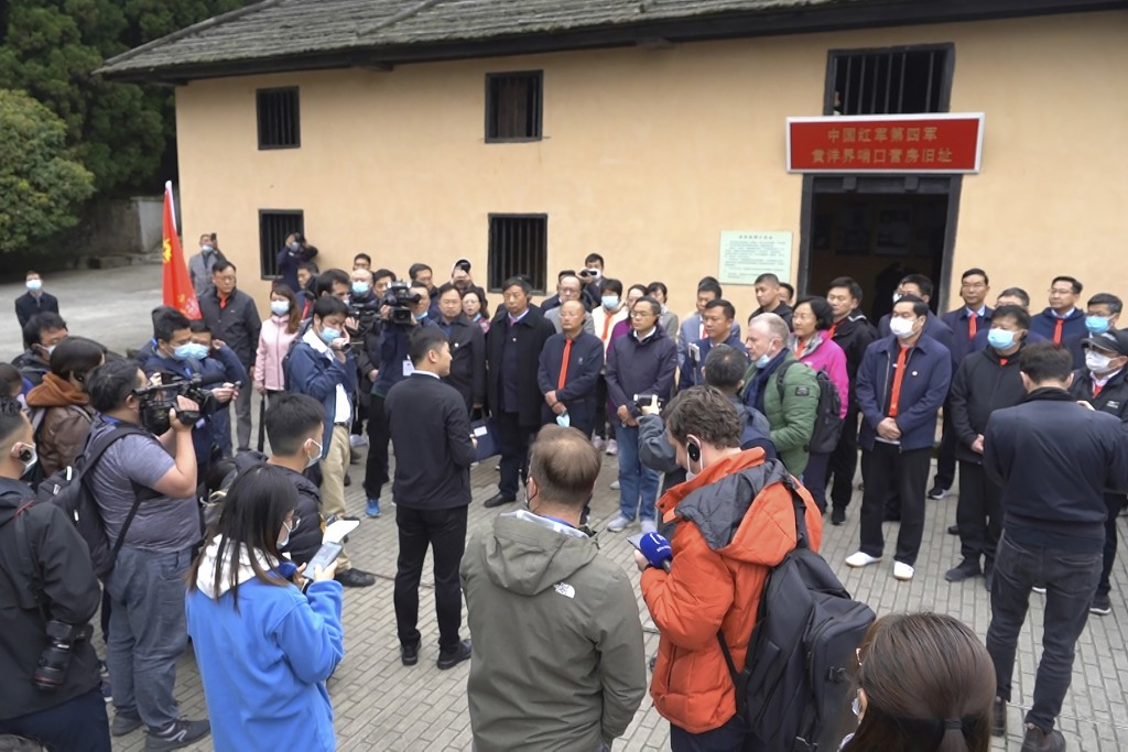 Students at the China Executive Leadership Academy gather in front of a revolutionary military outpost to listen to a field lecture in Jinggangshan in...