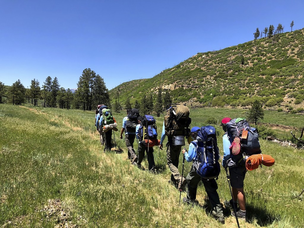 In this June 10, 2021 photo provided by Barry Bedlan, members of Troop 298 of Frisco, Texas are among the first to embark a 12-day trek across the Phi...