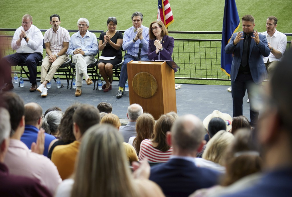 Oregon Governor Kate Brown thanks health care workers while announcing the end of the state's COVID-19 restrictions in Portland, Ore., Wednesday, June...