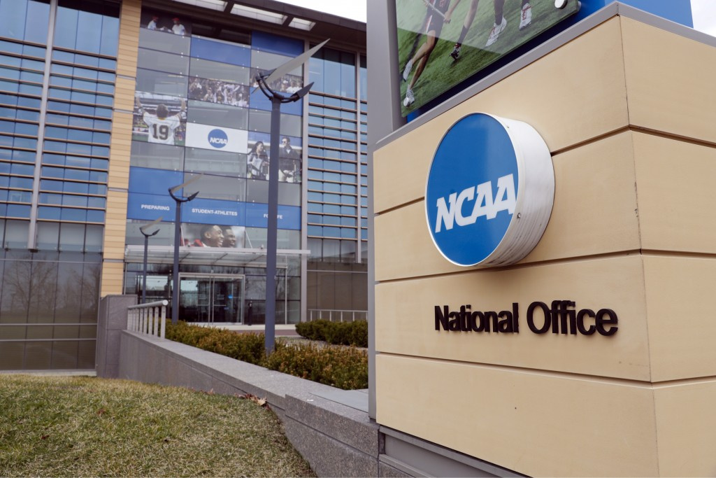 FILE - In this March 12, 2020, file photo, the national office of the NCAA in Indianapolis is shown. The NCAA Board of Directors is expected to greenl...
