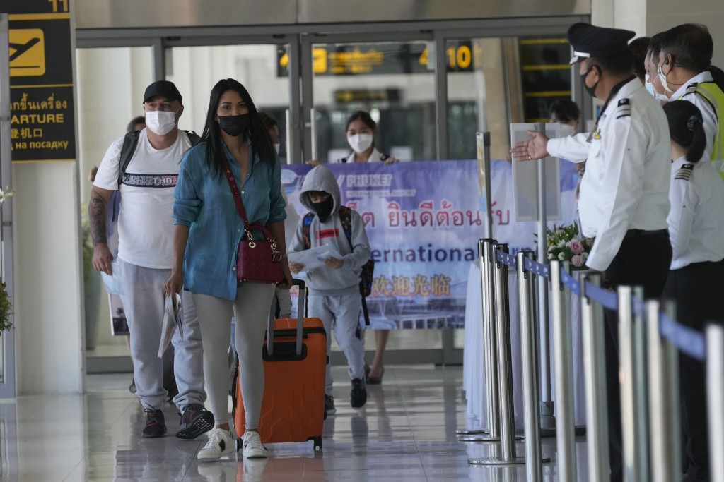 The first group of tourists arrive on an Etihad flight from Abu Dhabi at the Phuket International Airport in Phuket, Thailand, Thursday, July 1, 2021....
