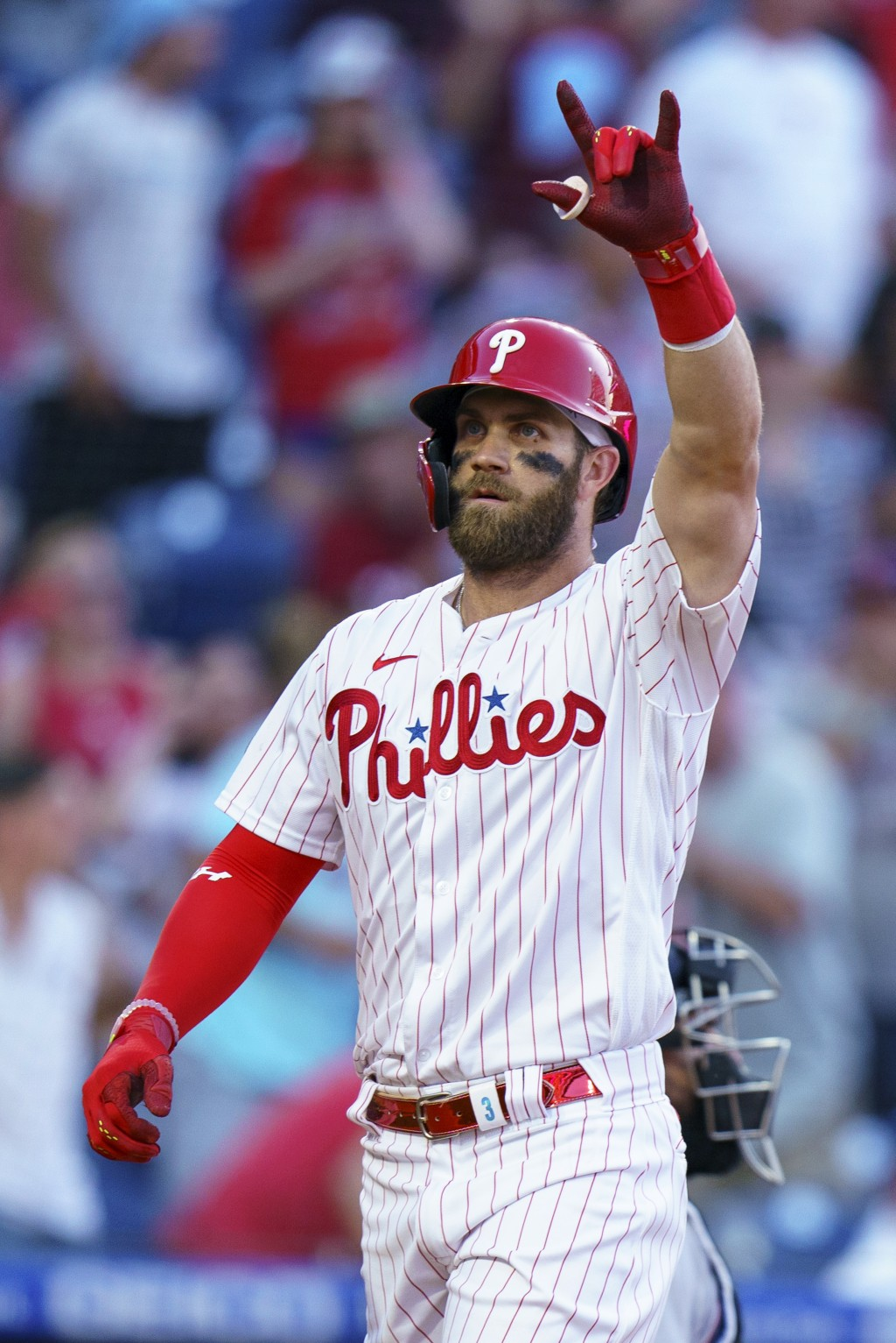 Philadelphia Phillies' Bryce Harper gestures after a home run during the second inning of the team's baseball game against the Miami Marlins, Wednesda...