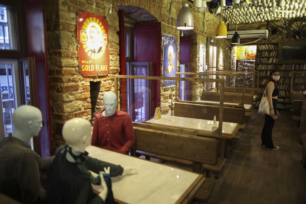 Mannequins that were used to be placed on tables to ensure social distancing to help curb the spread the coronavirus, are pictured in a restaurant in ...