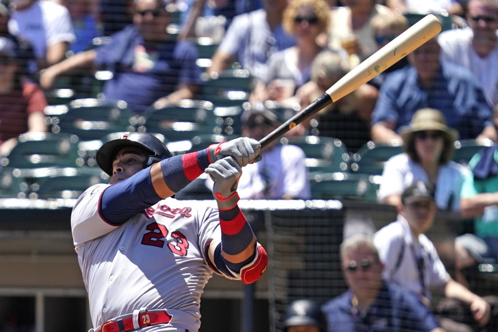 Minnesota Twins' Nelson Cruz hits a single during the first inning of a baseball game against the Chicago White Sox in Chicago, Thursday, July 1, 2021...