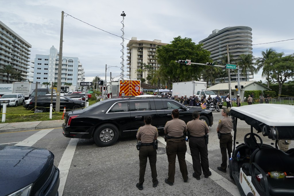 U.S. President Joe Biden arrives by car to visit a makeshift memorial to the scores of victims of the partial collapse of the Champlain Towers South, ...
