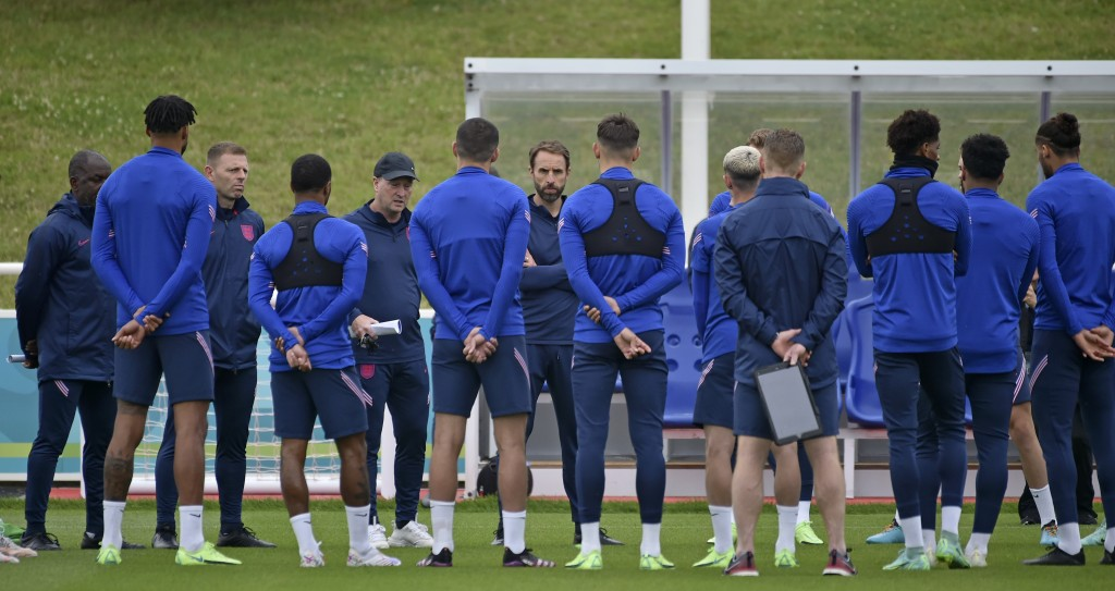 England's manager Gareth Southgate, centre, speaks to his players during a training session at St George's Park, Burton upon Trent, England, Friday Ju...