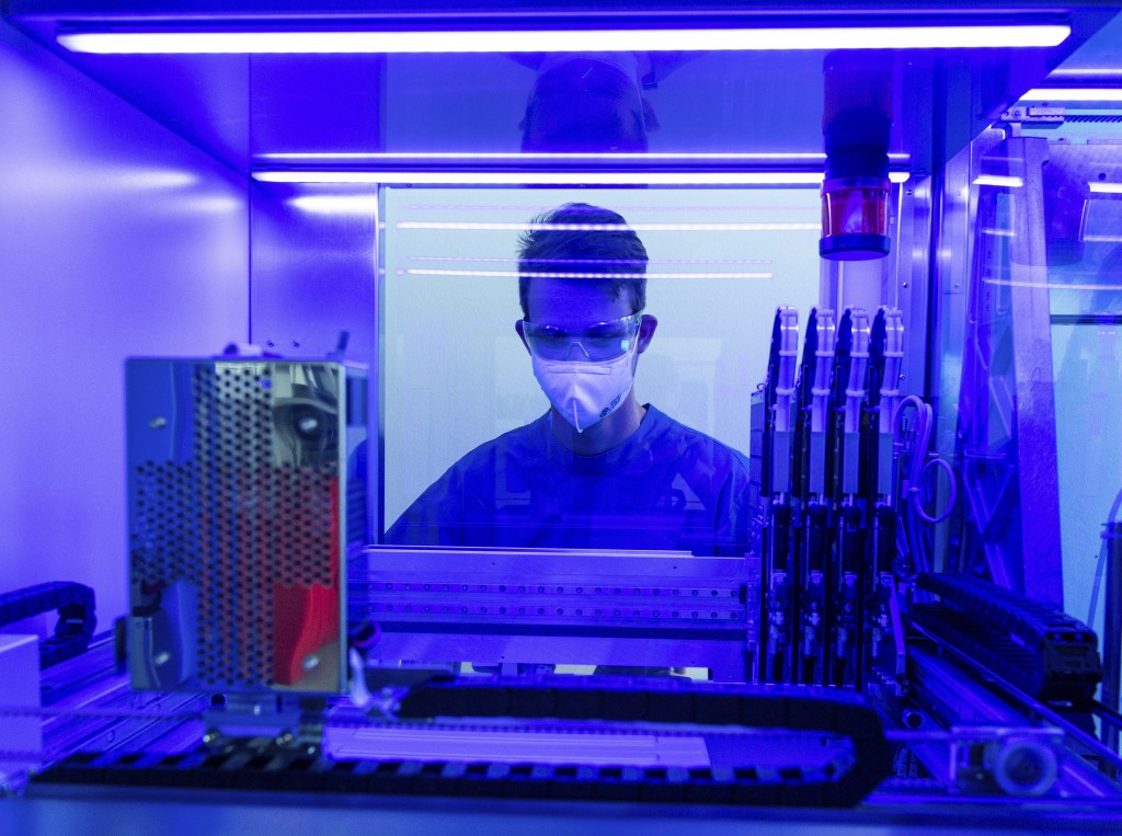 A laboratory technician stands at a fully automatic PCR machine in the Bioscientia laboratory for the examination of Corona smears in Ingelheim, Germa...