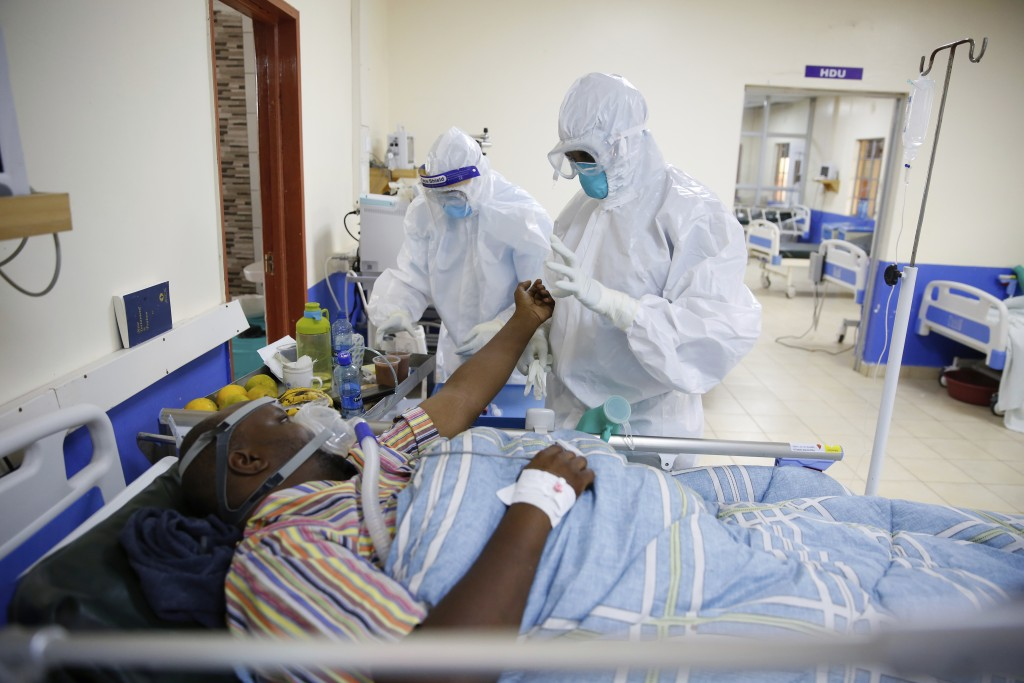 FILE — In this Thursday June 17, 2021 file photo medical staff wearing protective equipment attend to patients affected by COVID-19, on the Intensive ...