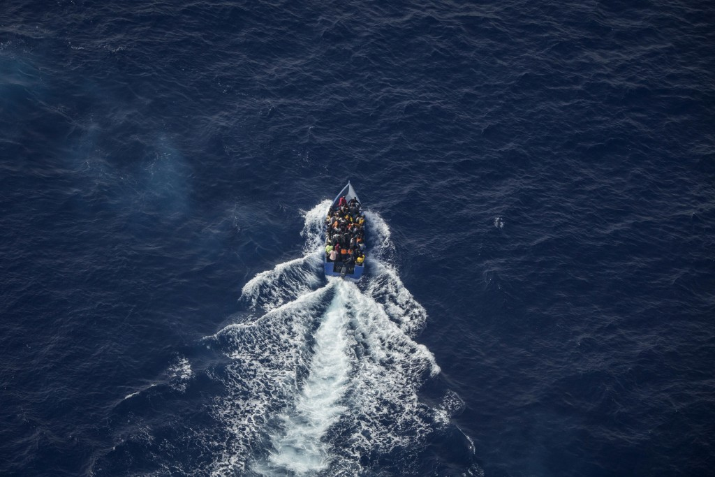 An overcrowded migrant boat tries to escape from the Libyan Coast Guard in the Mediterranean Sea, Wednesday, June 30, 2021. A non-profit sea rescue gr...