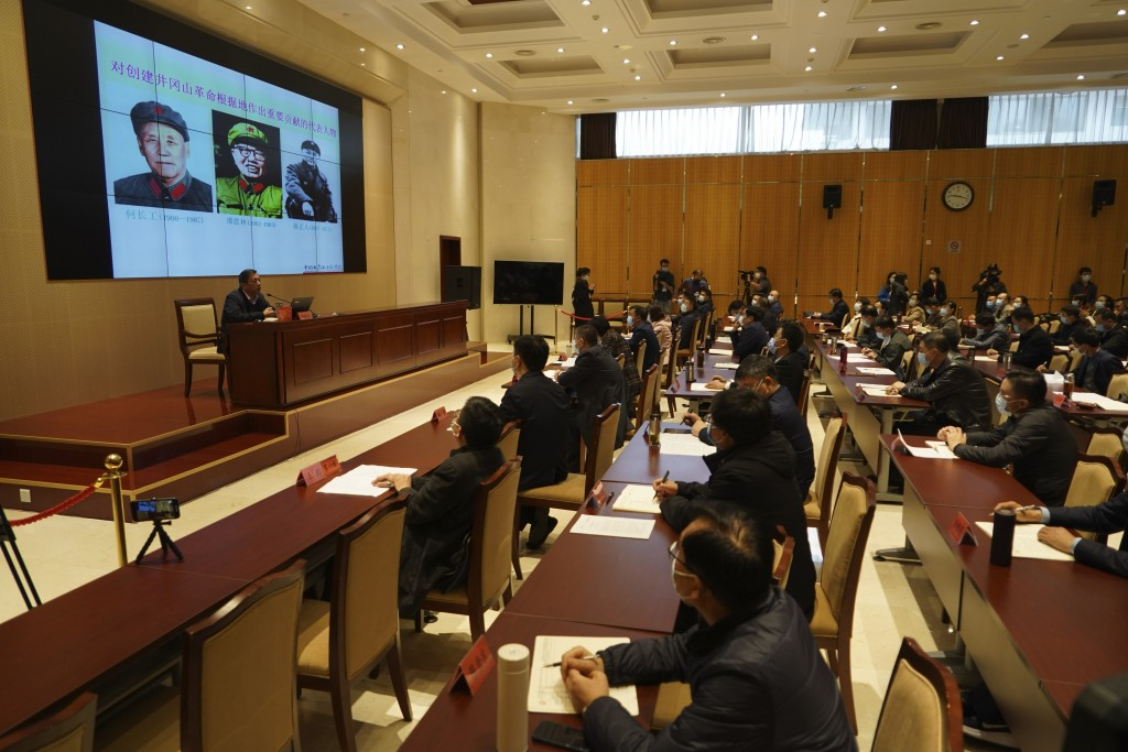Students at the China Executive Leadership Academy listen to a classroom lecture in Jinggangshan in southeastern China's Jiangxi Province, on April 9,...