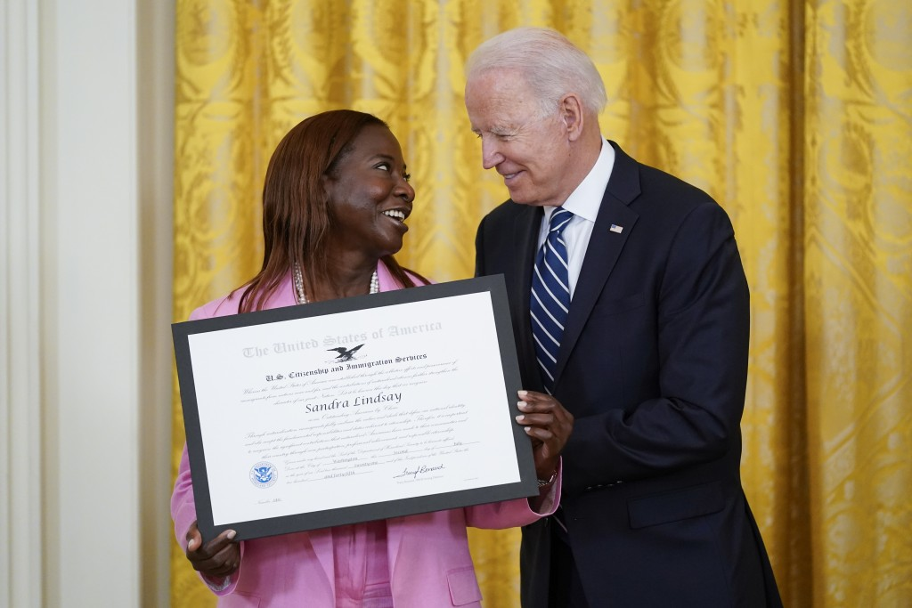 """President Joe Biden recognizes Sandra Lindsay as an """"Outstanding American by Choice,"""" a U.S. Citizenship and Immigration Services program that recogni..."""