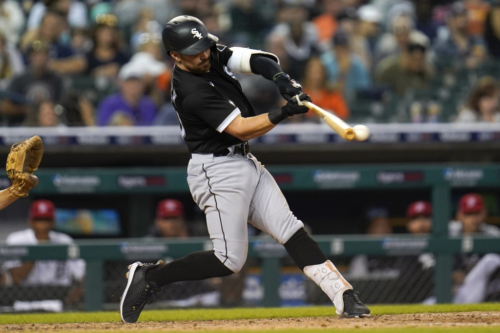 Chicago White Sox's Danny Mendick hits a sacrifice fly against the Detroit Tigers in the seventh inning of a baseball game in Detroit, Friday, July 2,...
