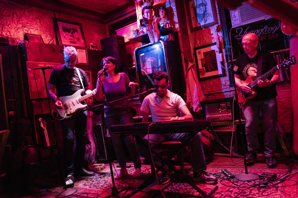 Elissa Montanti, founder and director at The Global Medical Relief Fund, second from left, performs with Ahmed Shareef, center right, at Liedy's Shore...