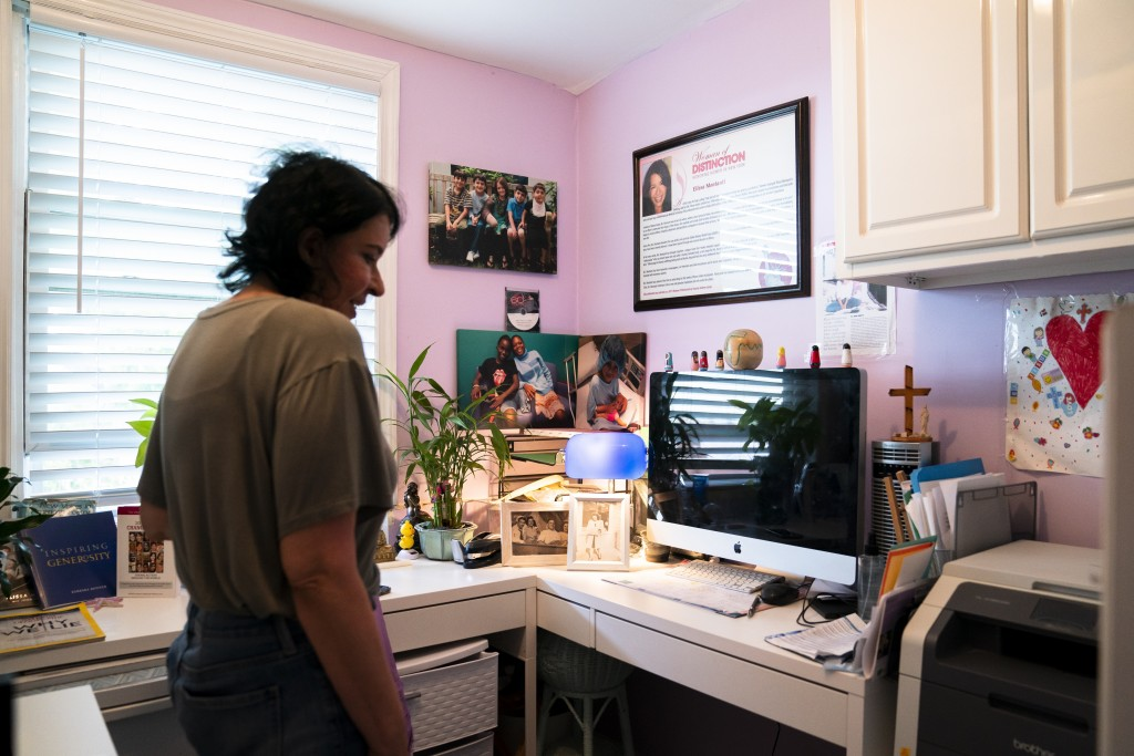 Elissa Montanti, founder and director at The Global Medical Relief Fund, stands in her office she created from a walk-in closet on her home's second f...