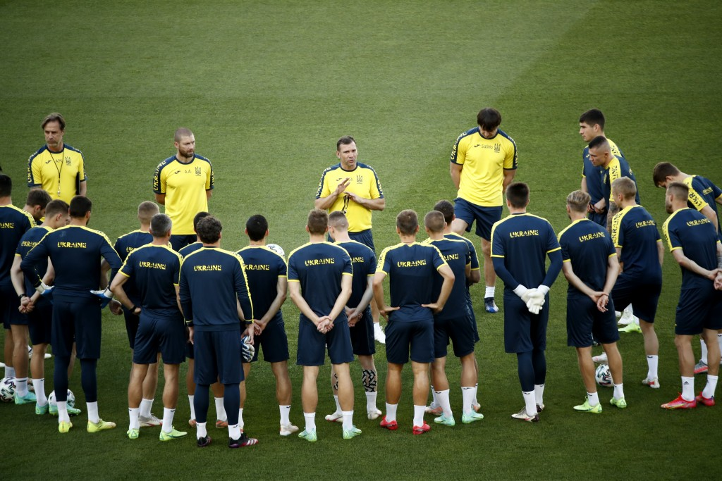 Ukraine's manager Andriy Shevchenko, center, talks to players during a training session at the Olympic stadium in Rome, Friday, July 2, 2021, ahead of...