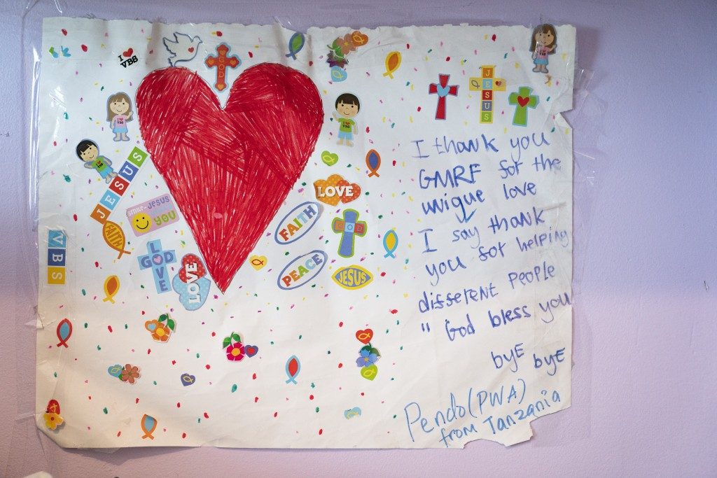 A thank you card written by Pendo Sengerena, a young amputee from Tanzania, hangs on the wall of Montanti's home office created from a walk-in closet,...