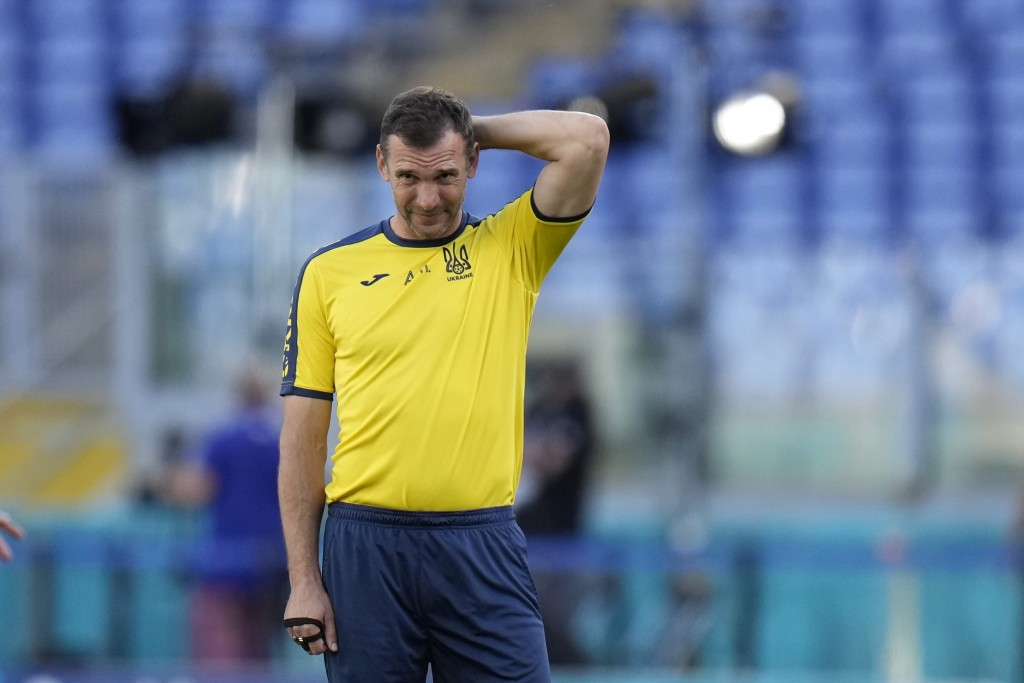 Ukraine's manager Andriy Shevchenko looks at players during a training session at the Olympic stadium in Rome, Friday, July 2, 2021, ahead of their Eu...