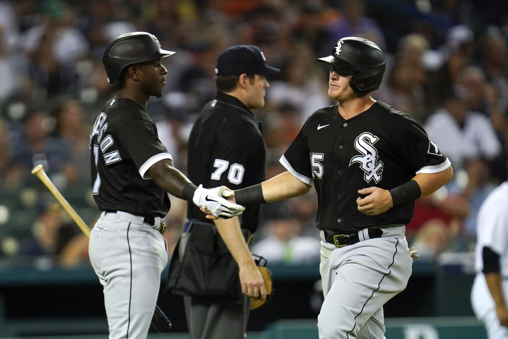 Chicago White Sox's Andrew Vaughn, right, celebrates scoring with Tim Anderson against the Detroit Tigers in the seventh inning of a baseball game in ...