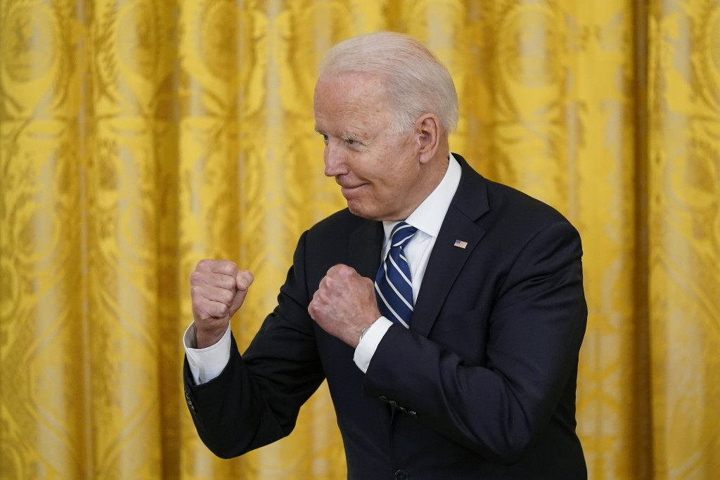 President Joe Biden gestures during a naturalization ceremony in the East Room of the White House, Friday, July 2, 2021, in Washington. (AP Photo/Patr...
