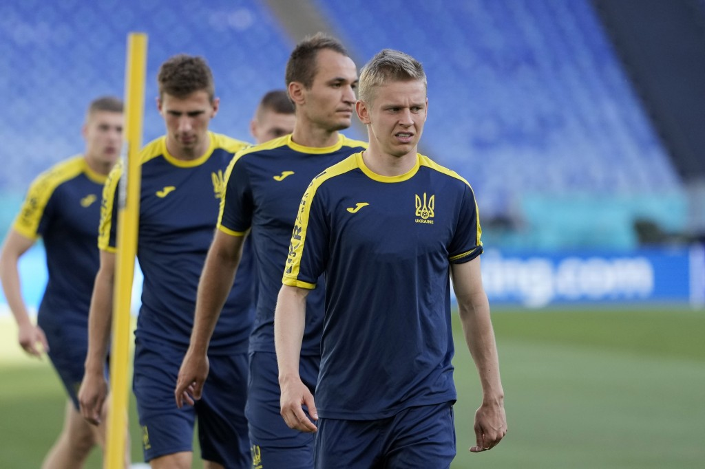 Ukraine's Oleksandr Zinchenko, right, looks on during a training session at the Olympic stadium in Rome, Friday, July 2, 2021, ahead of their Euro 202...