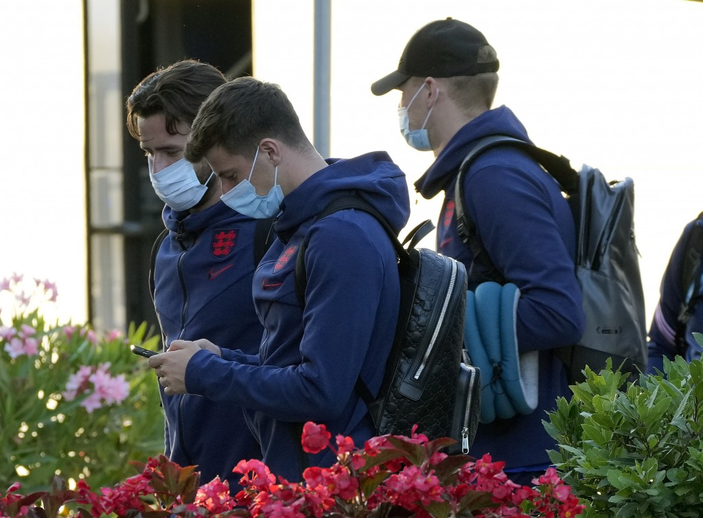 England's Ben Chilwell, left, and Mason Mount, centre, arrive at the A.Roma Lifestyle Hotel, in Rome, Friday, July 2, 2021. England is to play Ukraine...