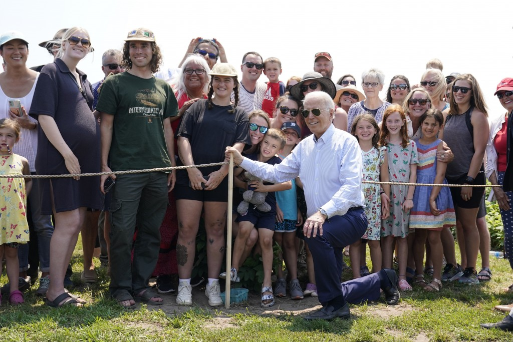President Joe Biden poses for a photo after touring King Orchards fruit farm Saturday, July 3, 2021, in Central Lake, Mich. (AP Photo/Alex Brandon)