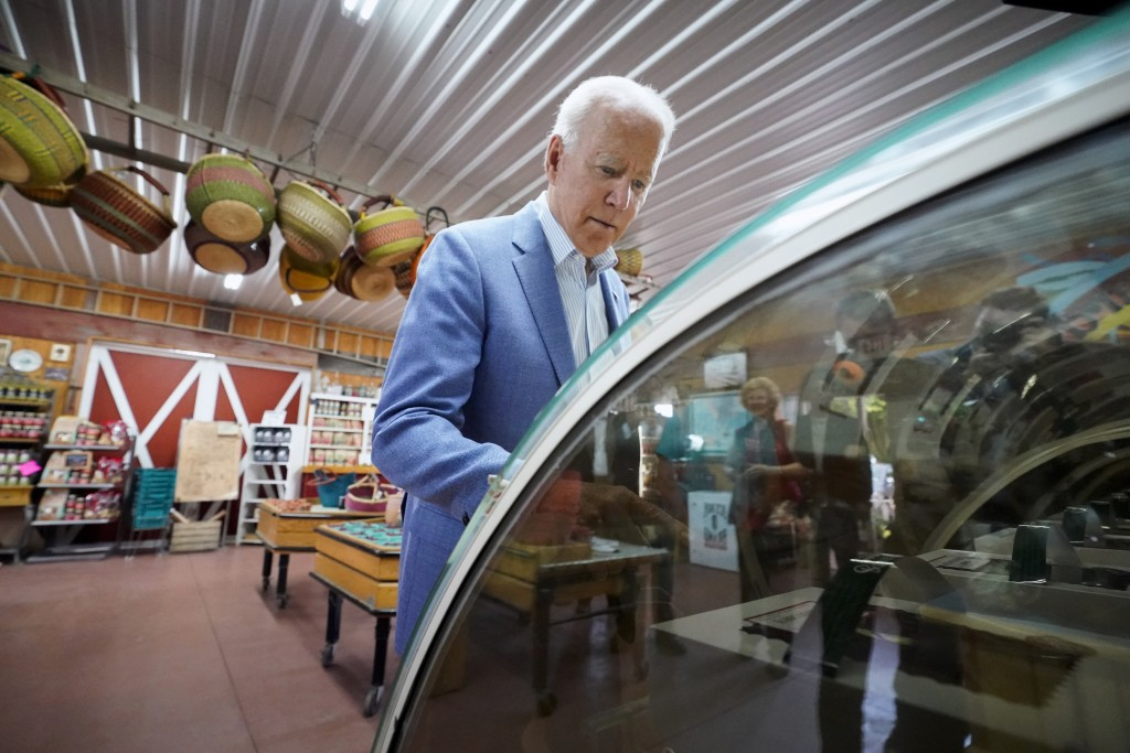 President Joe Biden look at pies in a case at the King Orchards fruit farm Saturday, July 3, 2021, in Central Lake, Mich. (AP Photo/Alex Brandon)