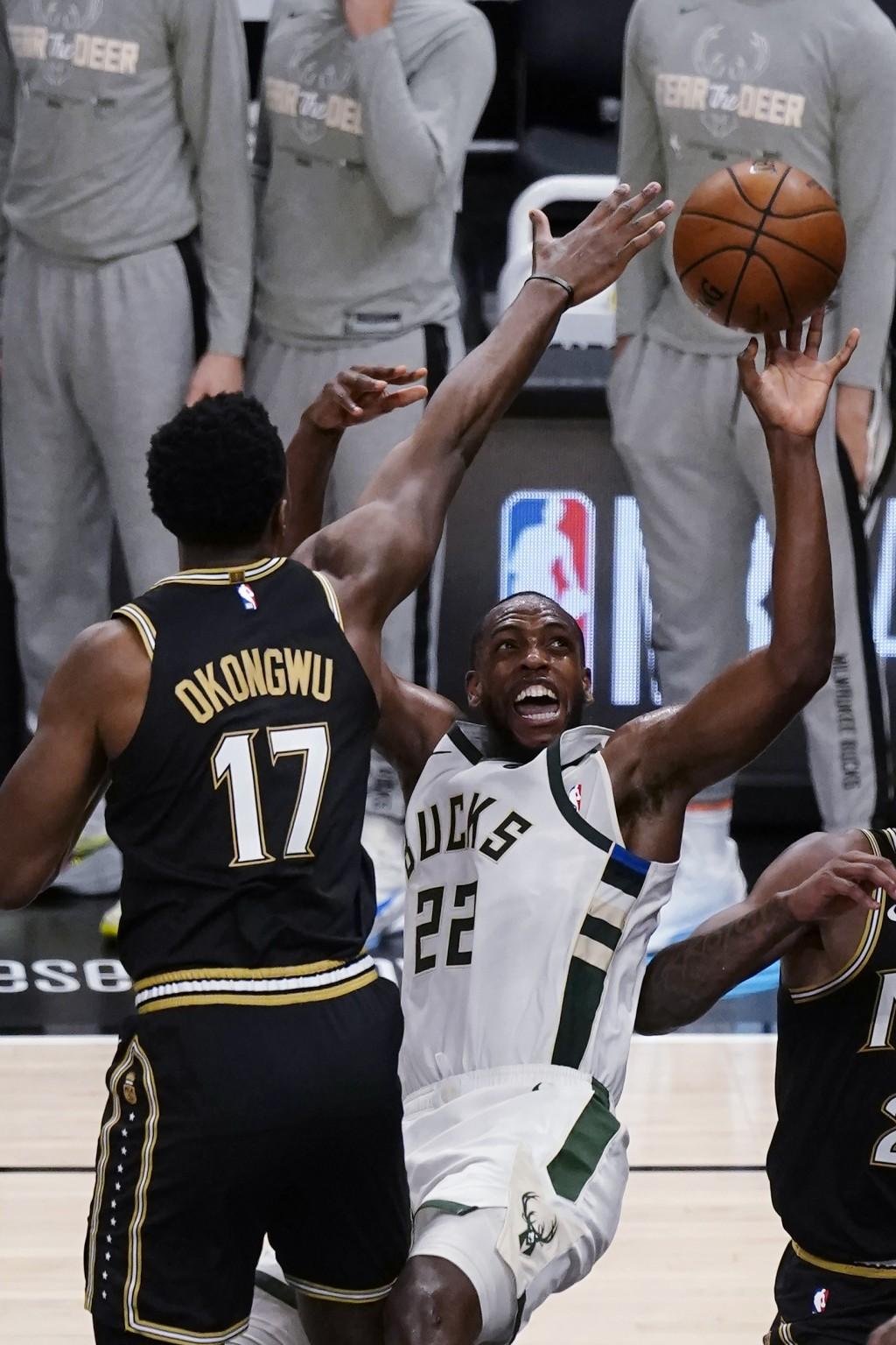 Milwaukee Bucks forward Khris Middleton (22) is fouled by Atlanta Hawks forward Onyeka Okongwu (17) during the second half of Game 6 of the Eastern Co...